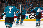Joonas Donskoi and Joel Ward of the San Jose Sharks celebrate the first goal of the night against the New York Rangers during a NHL game at the SAP...