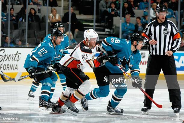 Joonas Donskoi and Tomas Hertl of the San Jose Sharks along withChris Wagner of the Anaheim Ducks go after the puck at SAP Center on November 20 2017...
