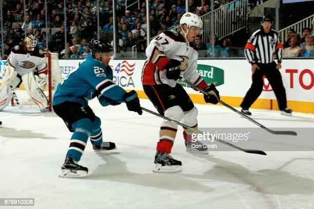 Joonas Donskoi defends Hampus Lindholm of the Anaheim Ducks at SAP Center on November 20 2017 in San Jose California
