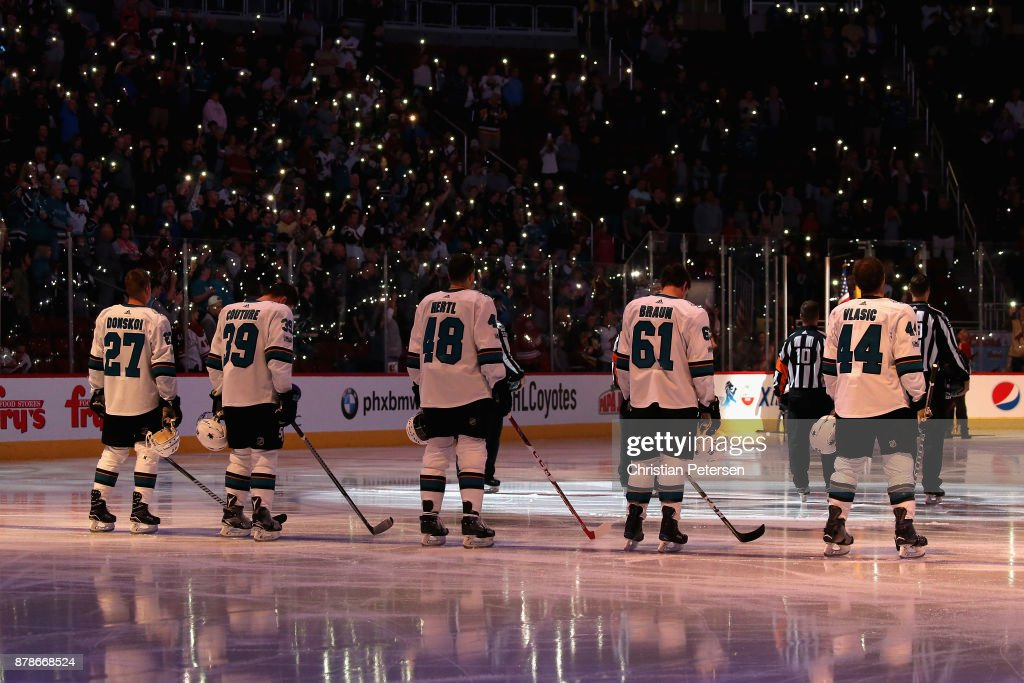 Joonas Donskoi #27, Logan Couture #39, Tomas Hertl #48, Justin Braun #61 and Marc-Edouard Vlasic #44 of the San Jose Sharks stand attended for the national anthme before the NHL game against the Arizona Coyotes at Gila River Arena on November 22, 2017 in Glendale, Arizona. The Sharks defeated the Coyotes 3-1.