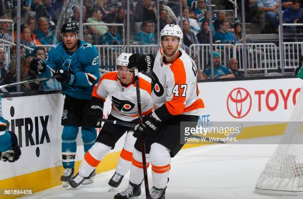Joonas Donskoi of the San Jose Sharks along with Ivan Provorov andAndrew MacDonald of the Philadelphia Flyers look during a NHL game at SAP Center at...
