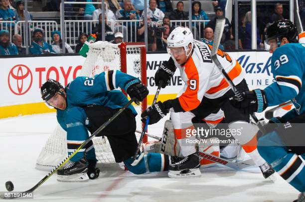 Joonas Donskoi of the San Jose Sharks and Ivan Provorov of the Philadelphia Flyers scramble for the puck at SAP Center at San Jose on October 4 2017...