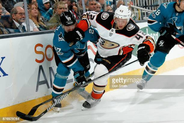Joonas Donskoi of the San Jose Sharks and Josh Mason of the Anaheim Ducks battle along the boards at SAP Center on November 20 2017 in San Jose...