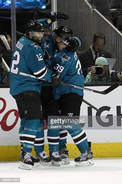 Joonas Donskoi of the San Jose Sharks celebrate his goal against the St Louis Blues with Patrick Marleau and Logan Couture in game three of the...