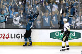 Joonas Donskoi of the San Jose Sharks celebrates his game winning goal in front of Evgeni Malkin of the Pittsburgh Penguins during overtime in Game...