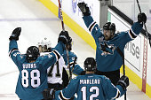 Joonas Donskoi of the San Jose Sharks celebrates his game winning goal with Chris Tierney Brent Burns and Patrick Marleau in front of Evgeni Malkin...