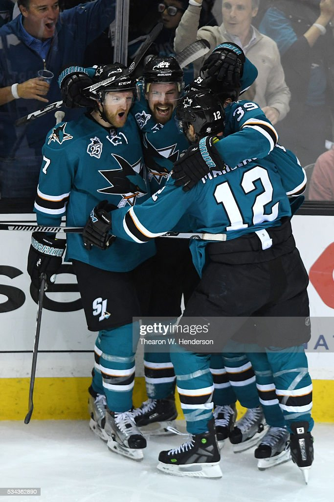 Joonas Donskoi of the San Jose Sharks celebrates his goal with teammates Paul Martin Patrick Marleau and Logan Couture in Game Six of the Western...