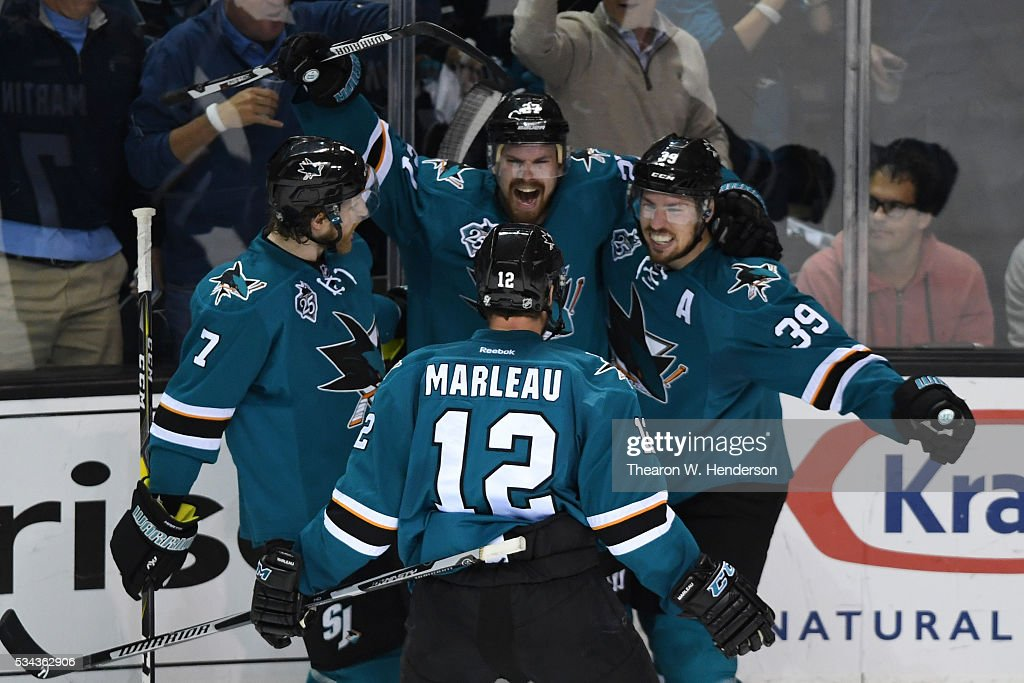 Joonas Donskoi #27 of the San Jose Sharks celebrates his goal with teammates Paul Martin #7, Patrick Marleau #12 and Logan Couture #39 in Game Six of the Western Conference Final against the St. Louis Blues during the 2016 NHL Stanley Cup Playoffs at SAP Center on May 25, 2016 in San Jose, California.