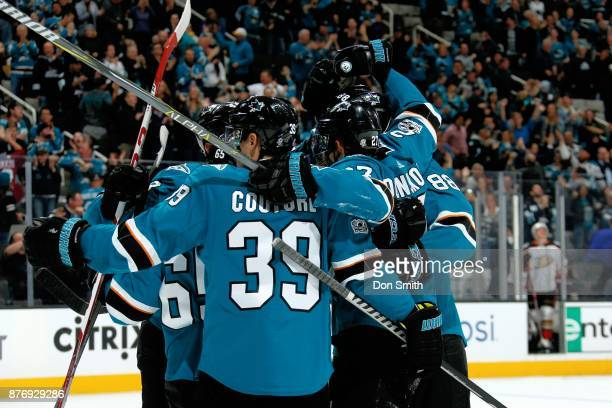 Joonas Donskoi of the San Jose Sharks celebrates his third period goal with teammates during a NHL game against the Anaheim Ducks at SAP Center on...