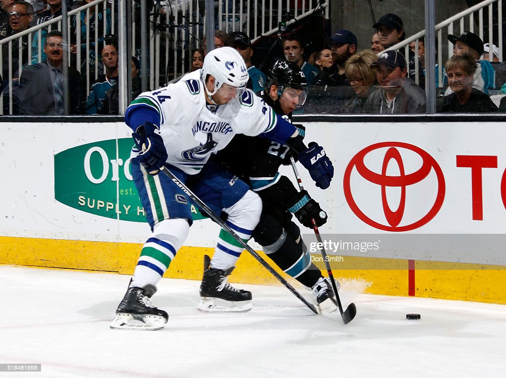 Joonas Donskoi #27 of the San Jose Sharks fends off Matt Bartkowski #44 of the Vancouver Canucks during a NHL game at the SAP Center at San Jose on March 31, 2016 in San Jose, California.