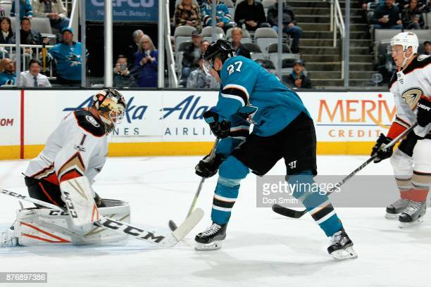 Joonas Donskoi of the San Jose Sharks gets the puck by Reto Berra of the Anaheim Ducks to score in the first period at SAP Center on November 20 2017...