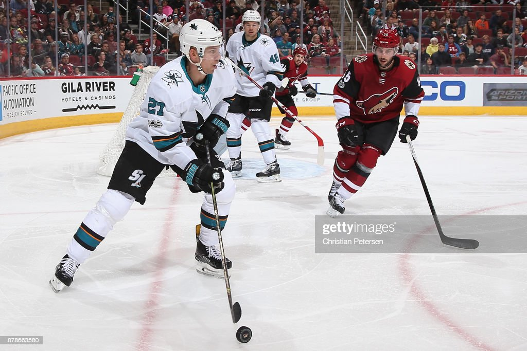 Joonas Donskoi #27 of the San Jose Sharks looks to center the puck around Jason Demers #55 of the Arizona Coyotes during the third period of the NHL game at Gila River Arena on November 22, 2017 in Glendale, Arizona. The Sharks defeated the Coyotes 3-1.