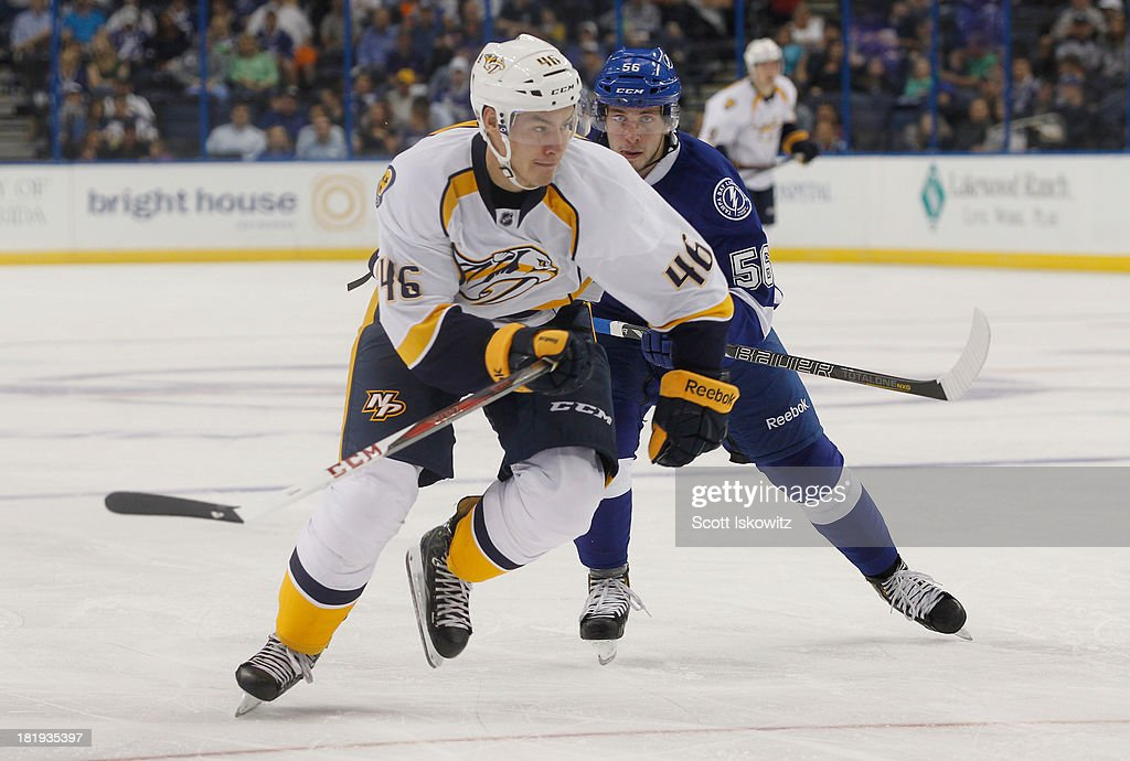 Joonas Jarvinen #46 of the Nashville Predators races to the puck against Nikita Kucherov #56 of the Tampa Bay Lightning at Tampa Bay Times Forum on September 19, 2013 in Tampa, Florida.