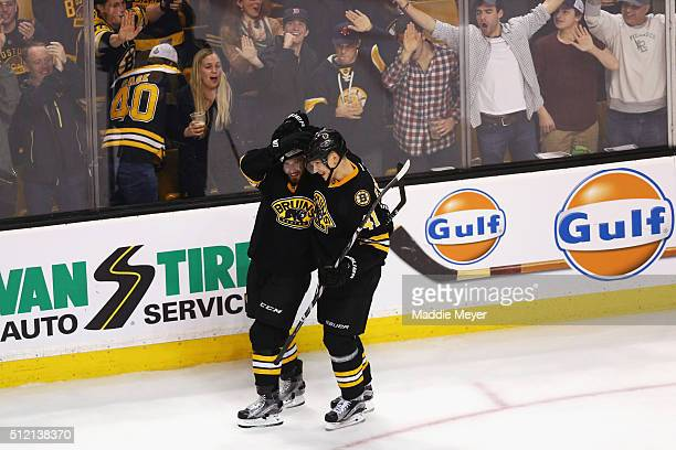 Joonas Kemppainen of the Boston Bruins congratulates Landon Ferraro after he scored against the Pittsburgh Penguins during the third period at TD...
