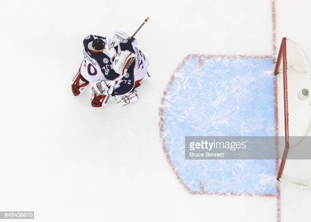 Joonas Korpisalo and Sergei Bobrovsky of the Columbus Blue Jackets celebrate a 30 victory over the New Jersey Devils at the Prudential Center on...