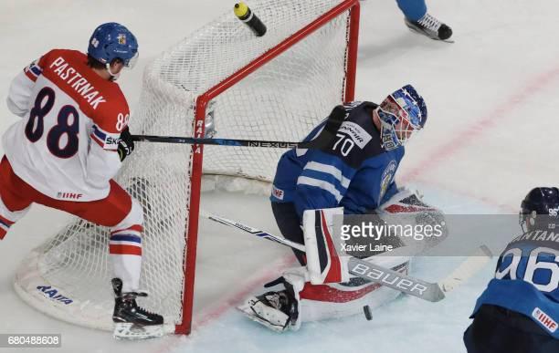 Joonas Korpisalo of Finland stop the puck over David Pastrnak of Czech Republic during the 2017 IIHF Ice Hockey World Championship game between...