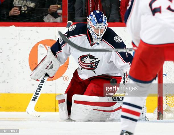 Joonas Korpisalo of the Columbus Blue Jackets blocks a Carolina Hurricanes shot during an NHL game on March 30 2017 at PNC Arena in Raleigh North...
