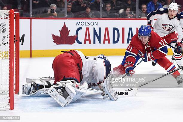 Joonas Korpisalo of the Columbus Blue Jackets blocks the shot by Brendan Gallagher of the Montreal Canadiens in the NHL game at the Bell Centre on...