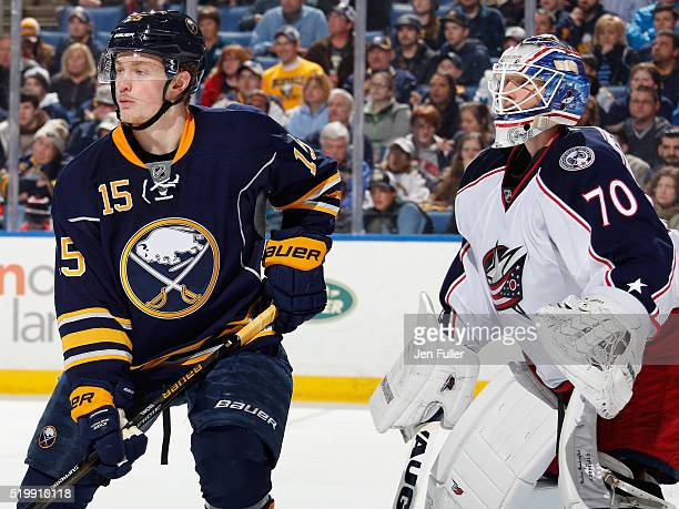 Joonas Korpisalo of the Columbus Blue Jackets defends the net against Jack Eichel of the Buffalo Sabres at First Niagara Center on April 8 2016 in...