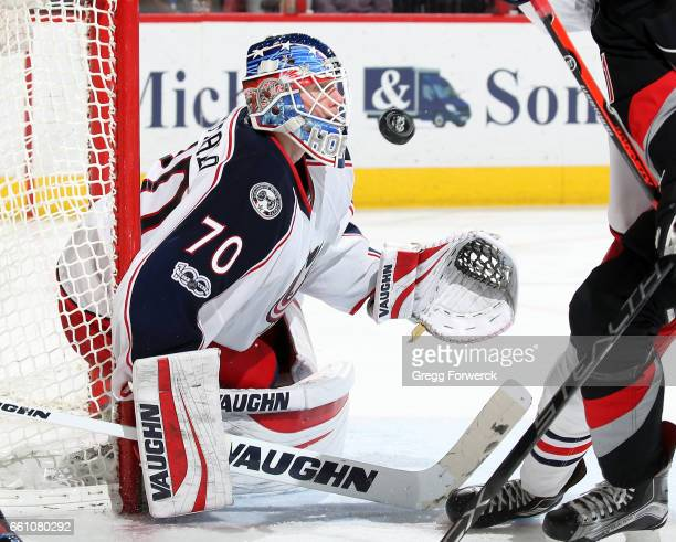 Joonas Korpisalo of the Columbus Blue Jackets eyes a puck during an NHL game against the Carolina Hurricanes on March 30 2017 at PNC Arena in Raleigh...