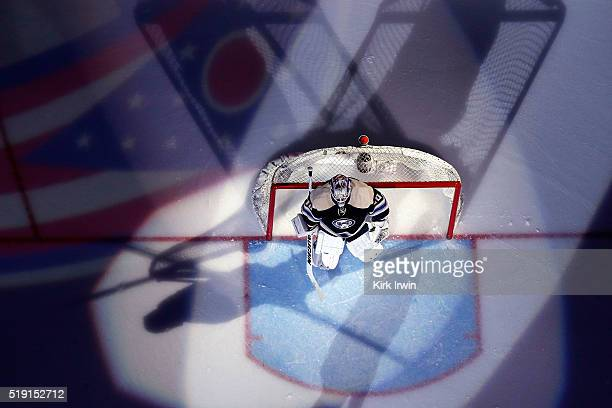 Joonas Korpisalo of the Columbus Blue Jackets is spot lit during player introductions prior to the start of the game against the New York Rangers on...