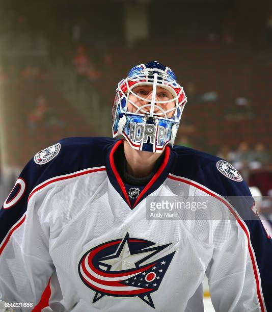 Joonas Korpisalo of the Columbus Blue Jackets looks on during pregame warmups prior to the game against the New Jersey Devils at Prudential Center on...