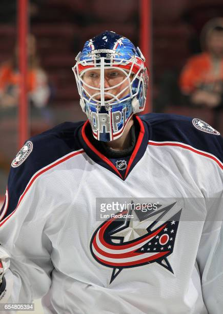Joonas Korpisalo of the Columbus Blue Jackets looks on during warmups against the Philadelphia Flyers on March 13 2017 at the Wells Fargo Center in...