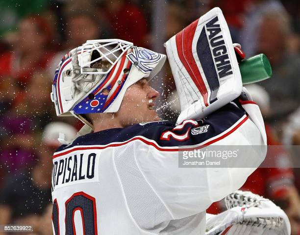 Joonas Korpisalo of the Columbus Blue Jackets sprays water on his face against the Chicago Blackhawks during a preseason game at the United Center on...