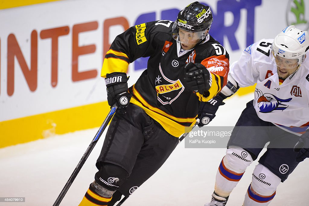 Joonas Lyytinen #57 of KalPa Kuopio against Ronny Arendt #57 of Adler Mannheim during the Champions Hockey League group stage game between KalPa Kuopio and Adler Mannheim on August 24, 2014 in in Kuopio, Finland.