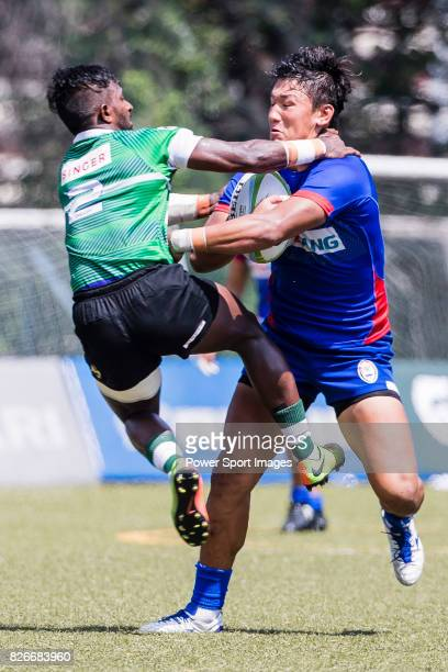 Joonbeom Park of Korea is tackled by Lahiru Herath Mudiyaselage of Sri Lanka during the Asia Rugby U20 Sevens 2017 at King's Park Sports Ground on...