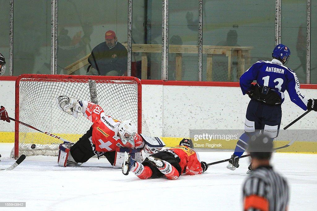 Joose Antonen #13 of Finland scores a goal on goaltender Daniel Guntern #20 of Switzerland during the U-18 Four Nations Cup tournament on November 9, 2012 at the Ann Arbor Ice Cube in Ann Arbor, Michigan. Finland won 5-1.