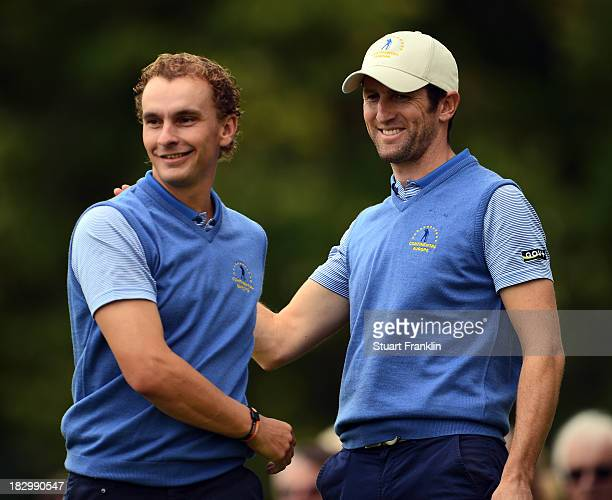 Joost Luiten and Gregory Bourdy of the European team celebrate during the first day's fourballs at the Seve Trophy at Golf de SaintNomlaBreteche on...