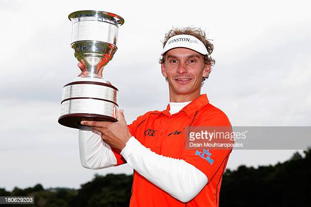 Joost Luiten of Netherlands celebrates with the Trophy after winning the KLM Open at Kennemer G CC on September 15 2013 in Zandvoort Netherlands