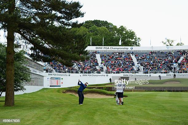 Joost Luiten of Netherlands plays his third shot on to the 18th green during day three of the BMW PGA Championship at Wentworth on May 24 2014 in...