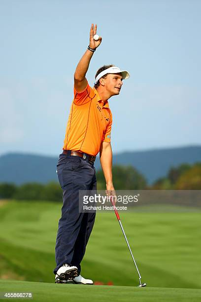Joost Luiten of the Netherlands celebrates after sinking the winning putt on day four of the ISPS Handa Wales Open at Celtic Manor Resort on...