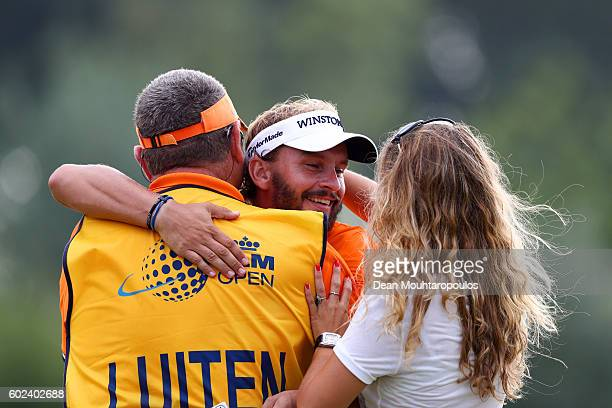 Joost Luiten of the Netherlands celebrates victory with his caddie Mike Waite and MelanieJane Lancaster on the 18th green during the final round on...