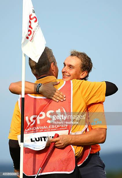 Joost Luiten of the Netherlands celebrates with his caddy after sinking the winning putt on day four of the ISPS Handa Wales Open at Celtic Manor...