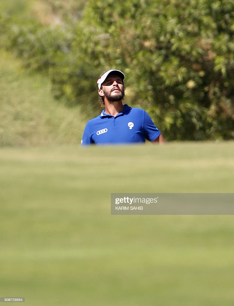 Joost Luiten of The Netherlands follows his ball after playing a shot during the third round of the 2016 Dubai Desert Classic at the Emirates Golf Club in Dubai on February 6, 2016. / AFP / KARIM SAHIB