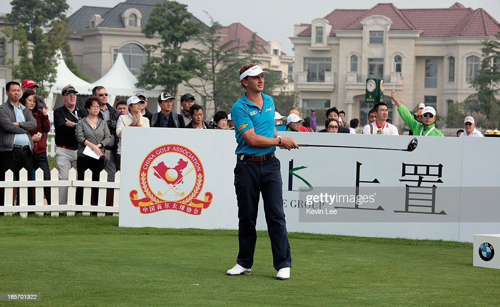 Joost Luiten of The Netherlands his his tee-shot on the first hole before withdrawing from the tournament during the first round of the BMW Masters at Lake Malaren Golf Club on October 24, 2013 in Shanghai, China.