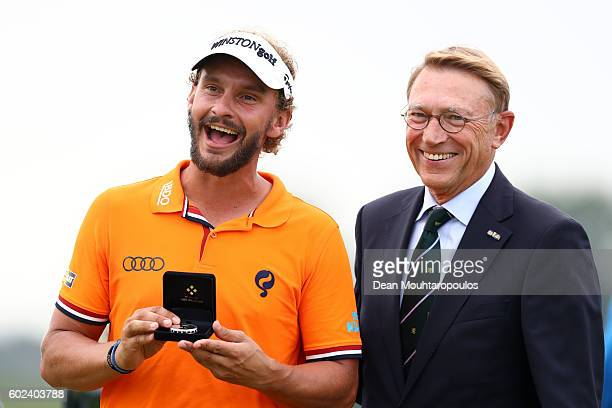 Joost Luiten of the Netherlands is presented with the award for best dutch player at the tournament after the final round on day four of the KLM Open...