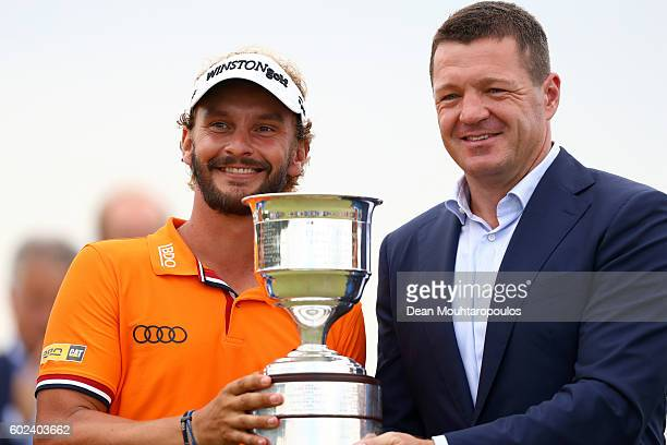 Joost Luiten of the Netherlands is presented with the trophy after the final round on day four of the KLM Open at The Dutch on September 11 2016 in...