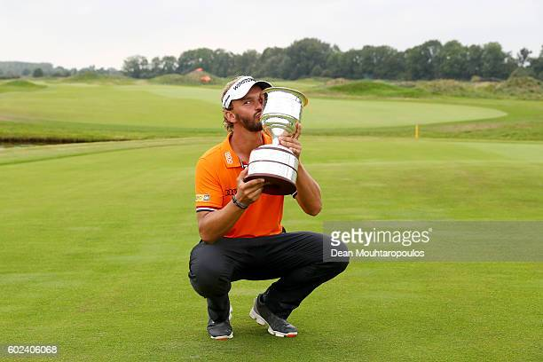 Joost Luiten of the Netherlands kisses the trophy as he celebrates victory after the final round on day four of the KLM Open at The Dutch on...
