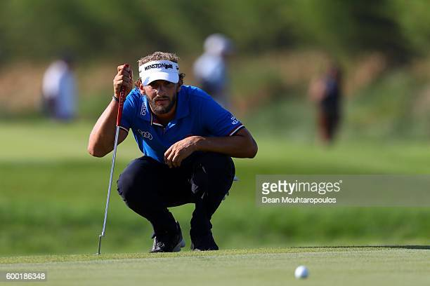 Joost Luiten of the Netherlands lines up a putt on the 18th green during the first round on day one of the KLM Open at The Dutch on September 8 2016...