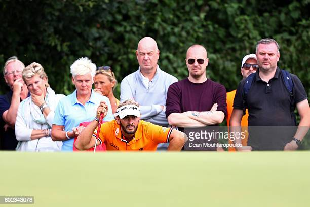 Joost Luiten of the Netherlands lines up a putt on the 5th green during the final round on day four of the KLM Open at The Dutch on September 11 2016...