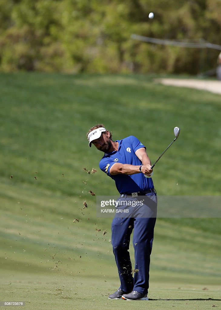 Joost Luiten of The Netherlands plays a shot during the third round of the 2016 Dubai Desert Classic at the Emirates Golf Club in Dubai on February 6, 2016. / AFP / KARIM SAHIB