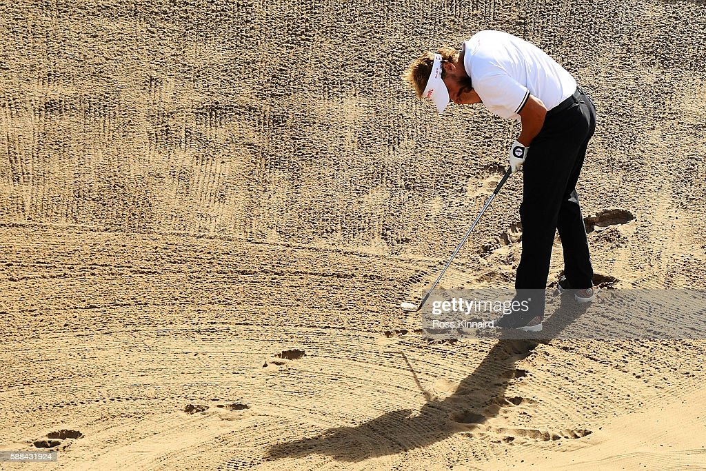 Joost Luiten of the Netherlands plays a shot from a bunker on the 16th hole during the first round of men's golf on Day 6 of the Rio 2016 Olympics at the Olympic Golf Course on August 12, 2016 in Rio de Janeiro, Brazil.