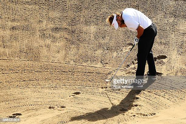 Joost Luiten of the Netherlands plays a shot from a bunker on the 16th hole during the first round of men's golf on Day 6 of the Rio 2016 Olympics at...