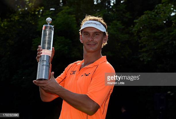 Joost Luiten of the Netherlands poses with the trophy after winning the Lyoness Open powered by Greenfinity on a score of 17 under par at Diamond...