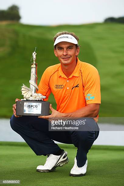 Joost Luiten of the Netherlands poses with the trophy following his victory on day four of the ISPS Handa Wales Open at Celtic Manor Resort on...