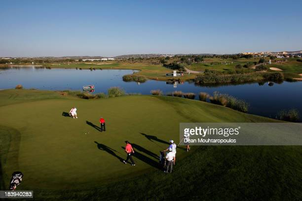 Joost Luiten of the Netherlands putts on the 13th green during the first round of the Portugal Masters at Oceanico Victoria Golf Course on October 10...